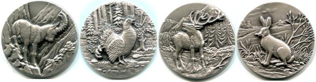 Niue Swiss wildllife coins: Alpine Ibes, Capercaillie, Red Deer, Mountain Hare